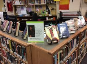 Photo of Library with Shusterman Bio on top